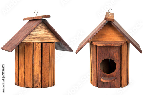 Wooden birdhouse isolated over white