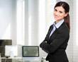 Happy businesswoman in her office