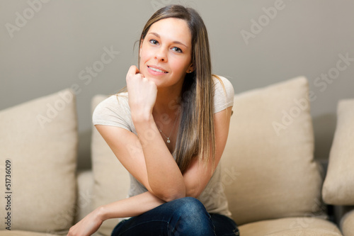 Young and beautiful woman on the sofa