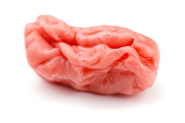 Piece of pink chewed bubble gum