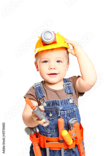 Boy in the orange helmet with tools on a white background