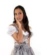 Wunderhübsche Frau im Dirndl vor weißem Hintergrund