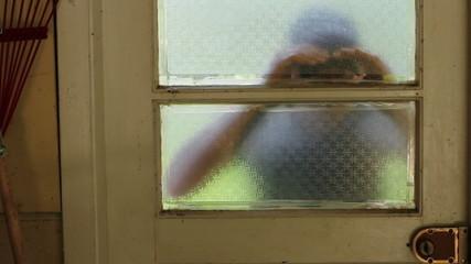 Intruder attempting to break into a garage, close up