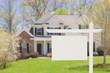 Leinwandbild Motiv Blank Real Estate Sign in Front of New House