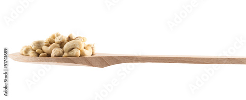 Spoon full of peanuts isolated