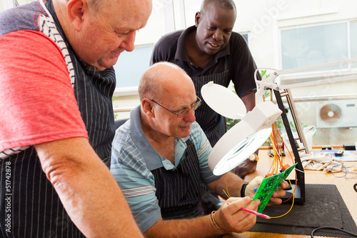 group of senior electrical technicians