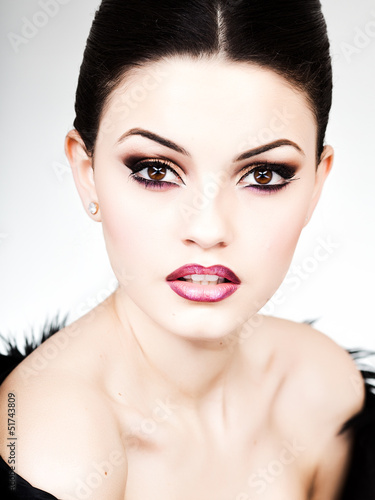 professional make-up and hairstyle on beautiful woman face