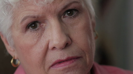 Close up shot of senior woman's face, unhappy