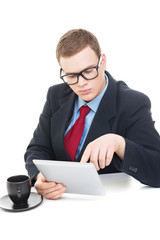 Young businessman wearing suit working on digital tablet