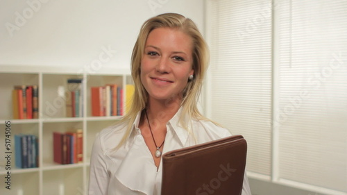 Portrait of a confident business woman in her office, dolly shot