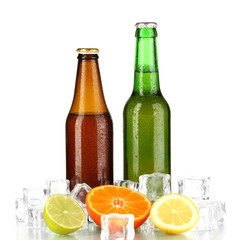Beer bottles in ice isolated on white