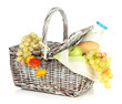 Picnic basket with fruits and bottle of milk, isolated on white