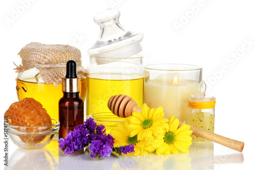 Fragrant honey spa with oils and honey isolated on white