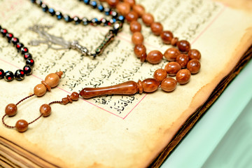Muslim rosary beads on the Holy Quran
