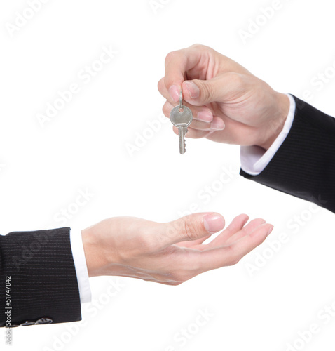 Male hand holding apartment keys