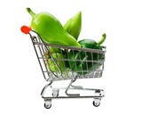 Green sweet pepper paprika  in shopping trolley isolated on whit