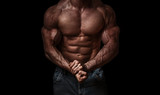 Bodybuilder isolated on black background