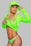 Fit blondie in bright green clothing