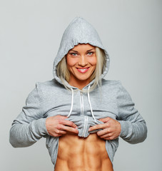 Smiling blond woman with cool abs