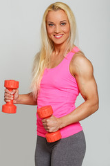 Pumped blondie with red dumbbells