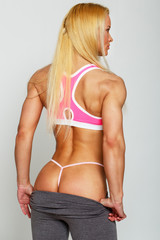 Fit blondie is demonstrating her pretty back