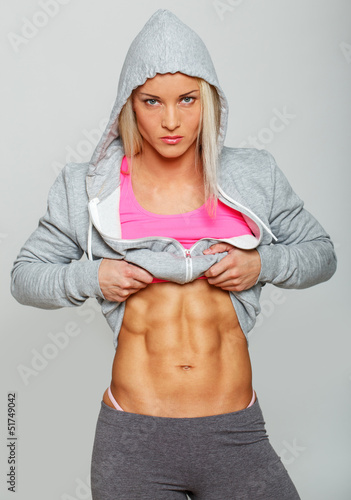 Serious woman with well trained abs
