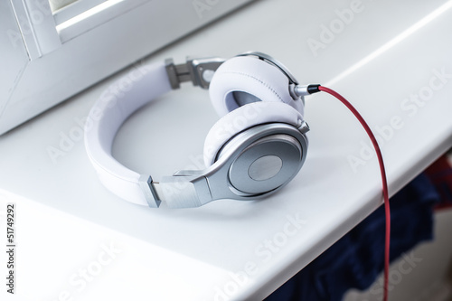 White headphones on the sill