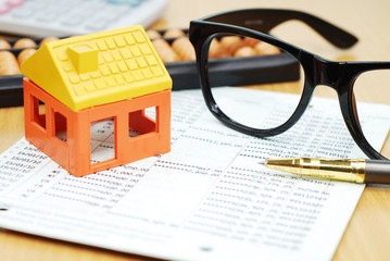 house model and office accessory on bank account ,business conce