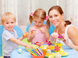 Young family paint Easter eggs