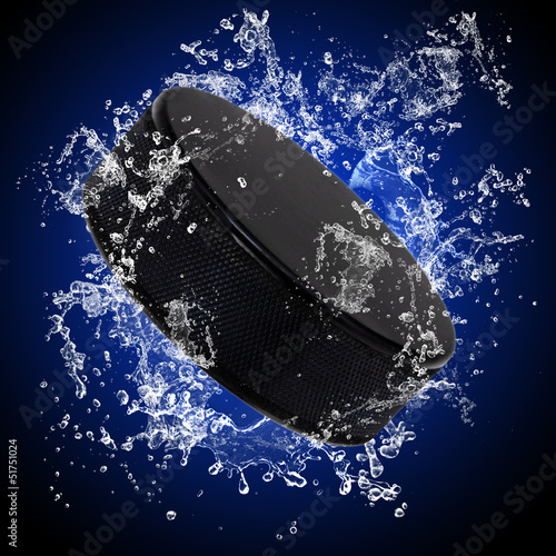 Hockey puck in splashing water