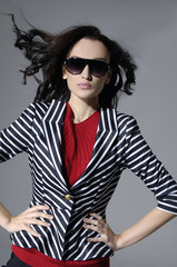 Pretty woman with arms folded wearing sunglasses
