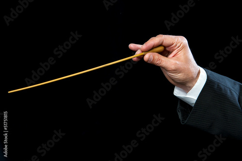 Conductors hand with baton.