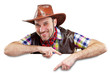 Cheerful cowboy holding a banner, isolated on white background