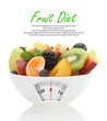 Diet meal. Fruit salad in a bowl with weight scale