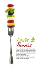 Fresh mixed slices of fruits on a fork