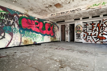 old destroyed building, large room with graffiti
