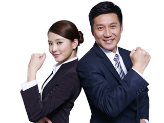 asian business people standing back-to-back, making a fist