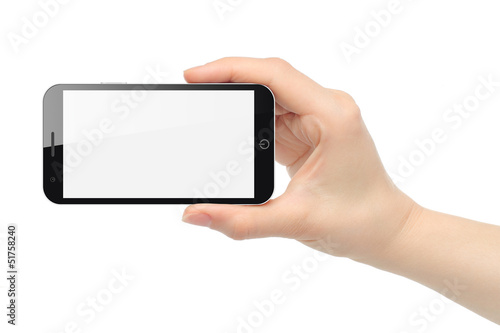 Hand holds smart phone isolated on white background .