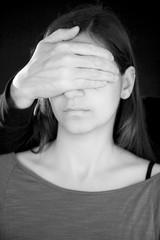 Man blinding woman black and white