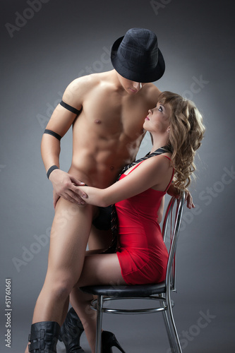 Naked guy sitting on passionate woman in red