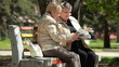 Senior Women Reading Magazines In The Park