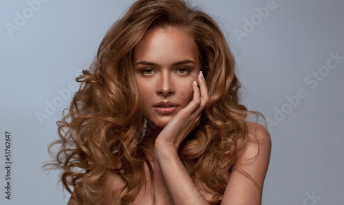 Portrait of beautiful natural woman with long hair