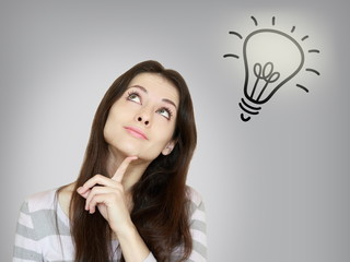 Thinking beautiful woman with idea bulb lamp above isolated on g