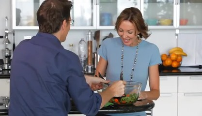 Caucasian couple sharing salad