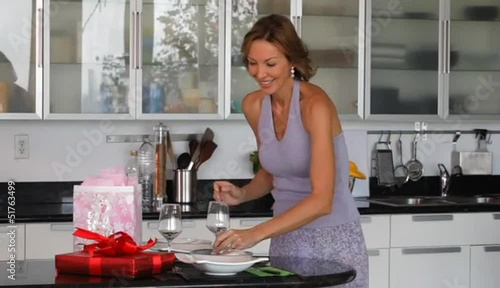 Caucasian woman setting birthday table
