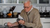 Senior Caucasian man checking his blood pressure