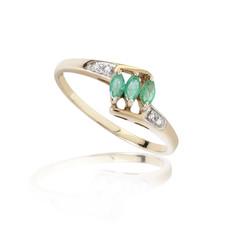 Luxury emerald golden ring decorates with diamonds on white