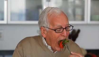 Close up of senior Caucasian man eating vegetables