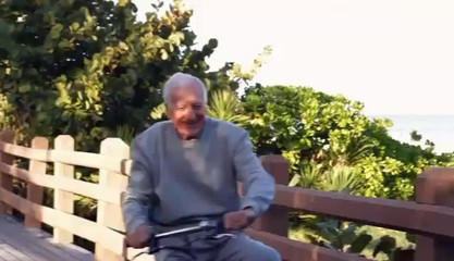 Senior Caucasian man having fun on bicycle