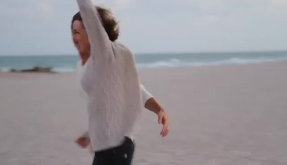Caucasian couple running on the beach